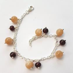 Silver bracelet and charms of semi precious stones